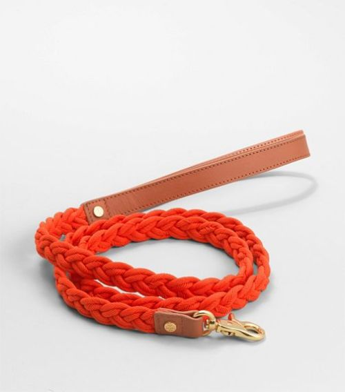 For the pup that has everything, how about this Tory Burch leash in orange and natural leather?